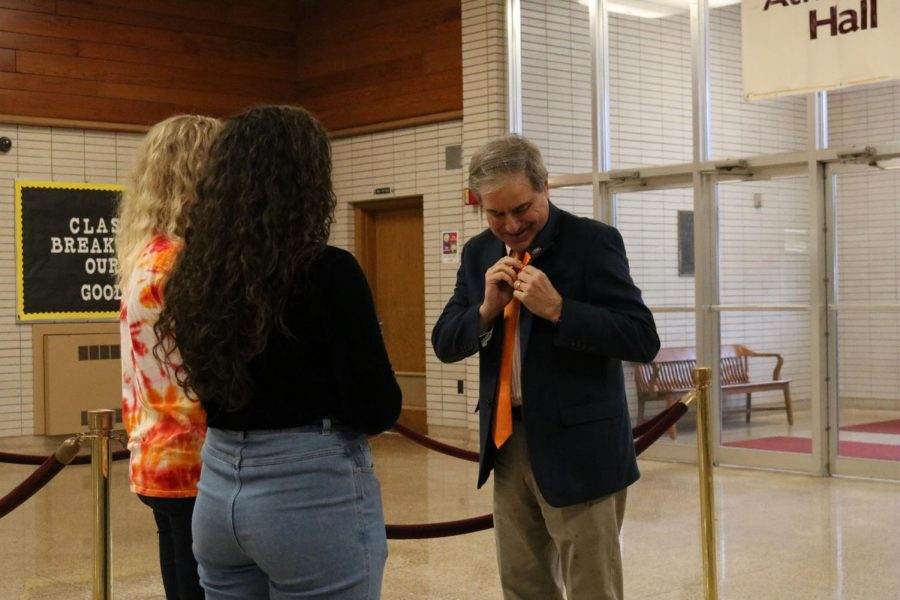 Congressman John Yarmuth receives a ribbon from Atherton High School seniors Elena Nunez and Hailey Streble.