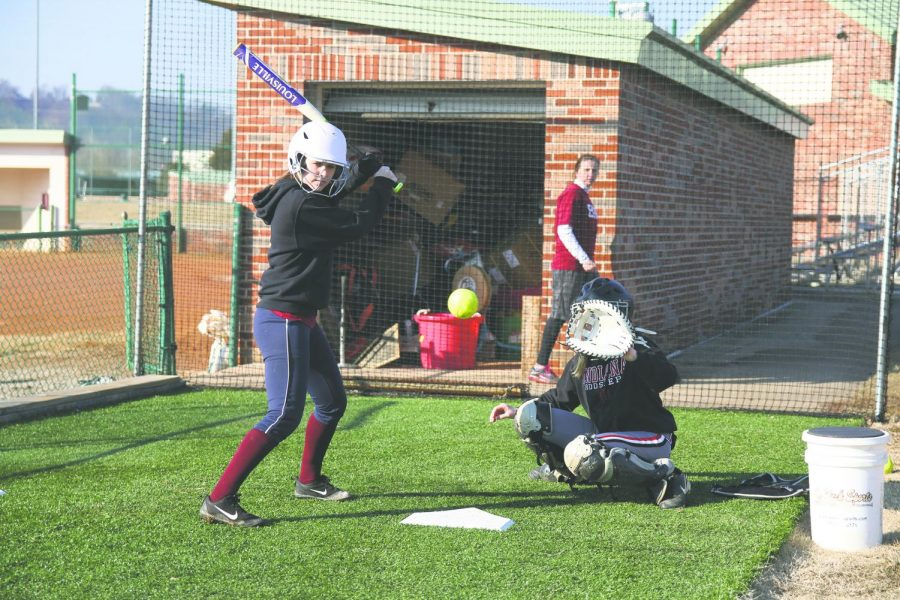 Kyndyl Olds, sophomore outfielder, stands in the box to help pitchers warm up. Photo by Tamar Kelly.