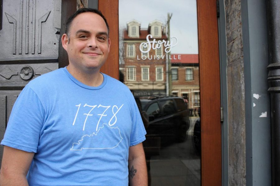 CEO of Yes Louisville, Jason Mudd, poses next to his office building wearing a Yes Brand shirt in Nulu, Louisville.