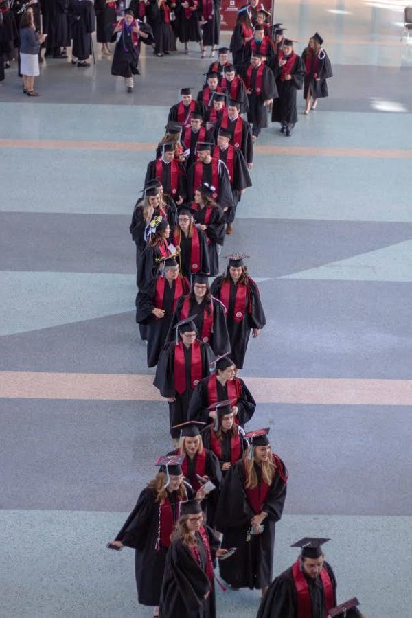 The line of caps and gowns filed steadily into Freedom Hall.