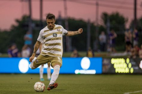 """Louisville City forward, Cameron Lancaster, takes a free kick during a 6-0 rout of the Richmond Kickers. The club is hosting """"College Night"""" for students on Aug. 31."""
