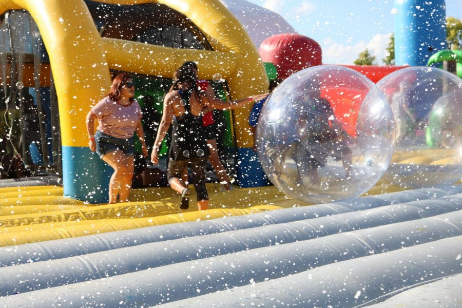 A bubble machine shoots out bubbles onto the jumpers. Photo by Meleena Richardson