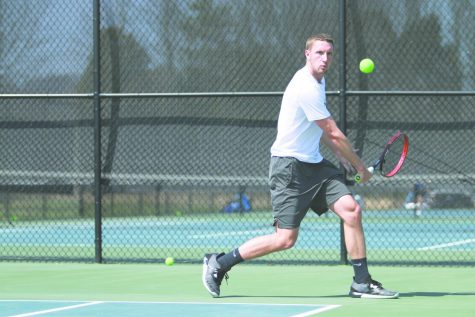Junior Sam Venter sets up a backhanded return in a Spring 2018 match. Venter is one of four juniors who Epkey believes will lead the men's team this season.