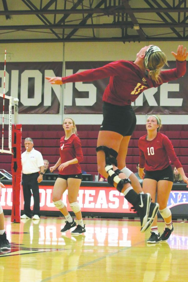 Senior outside hitter Monica Loftus rises up for a hit against Lindsey Wilson College. Loftus finished the match with 10 kills. Photo by Tamar Kelly.