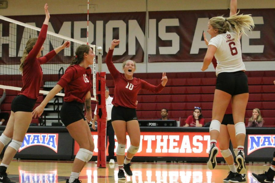 The Grenadier volleyball team celebrates after taking the third set against the defending national champions from Lindsey Wilson College. The Grenadiers would go on to lose the match 3-1. Photo by Tamar Kelly.