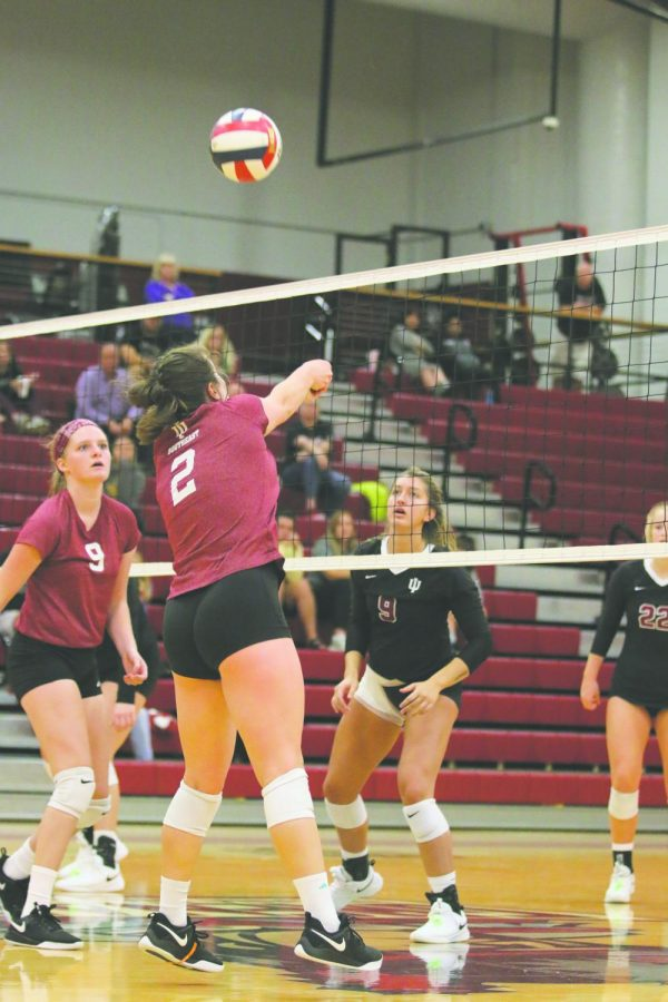 Hannah Sipe sets the ball for an outside hitter in the Grenadiers 3-0 loss to IU Kokomo. Sipe finished the match with 20 assists to lead the Grenadiers. Photo by Tamar Kelly.