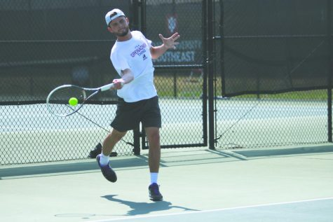 IU Southeast men's tennis junior, Garrett Fensler, swings through a forehanded return in a Spring 2018 match. Fensler earned all-conference honors for his second consecutive season in 2017-18.