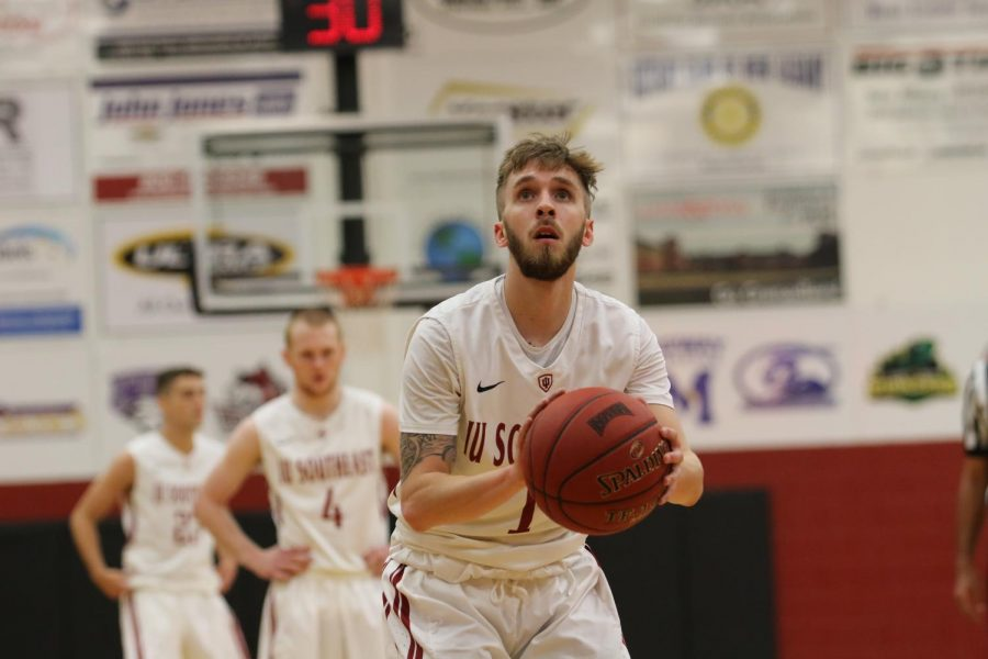 Freshman guard Brian Alvey attempts a free throw in the Grenadiers' 114-64 Homecoming victory. Alvey led the Grenadiers with five 3-pointers and finished the contest with 16 points. Photo by Tamar Kelly.