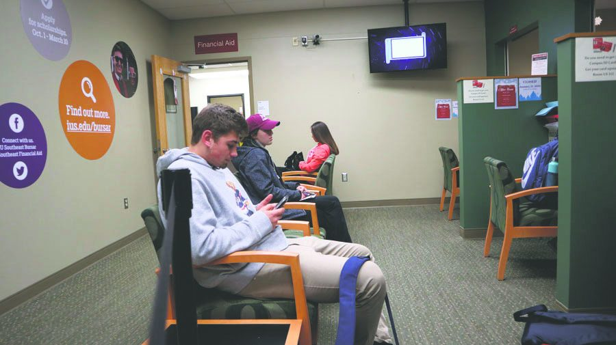 Anthony Hodge, undecided sophomore and Jessica Kay, nursing freshman, waiting in line to pay their bursar bills during the first week of classes.