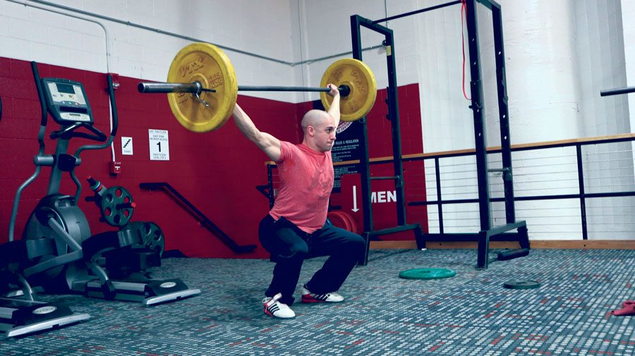 Graduate student Damon Russel power lifting at the IUS fitness center