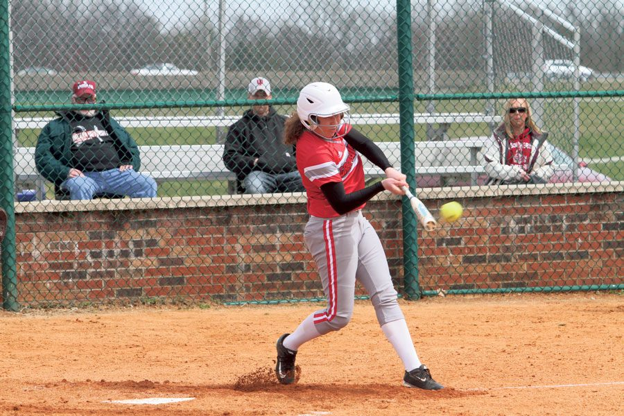 Senior pitcher Becca Schoenung hits a fastball to avoid a strike. Photo courtesy of IUS Athletics, used with permission.