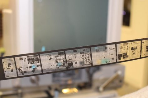 Pictured above, the microfilm is a long strip of miniature documents. Photo by Kaitlyn Lynn.