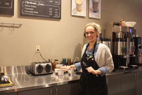 Three years barista Savannah Sikele finishes packaging up to-go coffee cups for customers. She said she really enjoys getting to know the customers and their lives, making it more than just a job opportunity for her. Photo by Callie Manias.