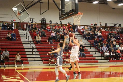 Senior Josie Hockman goes up for a fastbreak layup in the third quarter against Asbury. The field goal helped Hockman eclipse the 1,000 point mark for her career.