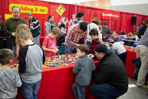 Children and guardians gather at the Lego Building Zone to create projects of their own.