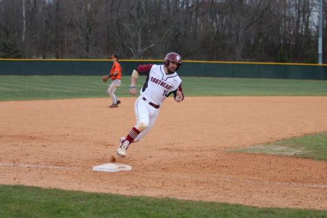 Danny Brescia rounds third in the Grenadiers matchup with Bryan University. Photo courtesy of the IUS Athletics Department.