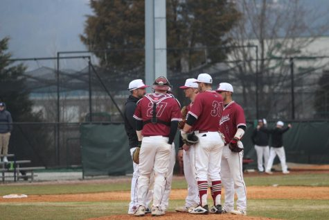 Head Coach Ben Reel and the IUS baseball infield gather around relief pitcher Owen Evans during game one of last Saturday's doubleheader against Rio Grande.