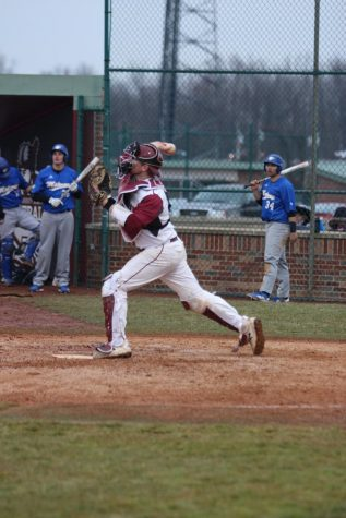Catcher Brody Tanksley fires to second base to conclude a pre-inning warm up versus Midway University.