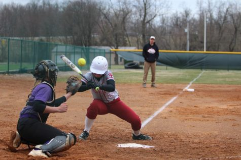 Maddie Probus gets hit in the shoulder by a pitch in game one of a doubleheader versus Carlow University last Friday.