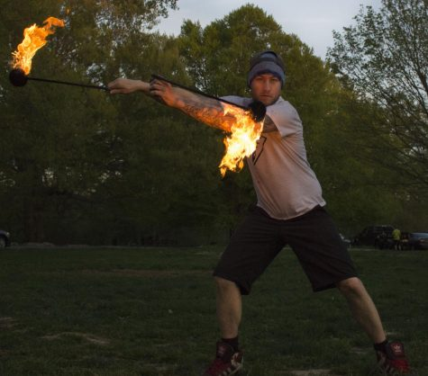 Benjamin Lacy (Benjamin Dragon) spins fire poi at Cherokee Park during a Tuesday evening flow jam.