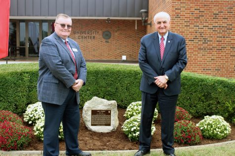 IUS Chancellor Ray Wallace (left) and IU President Michael McRobbie (right) pose in front of Lyda Radford's historical marker.