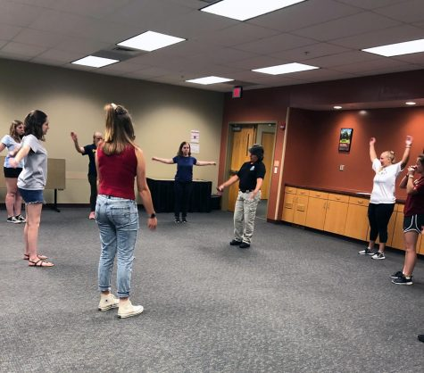 Monica Burnell-Wise leads off exercises to get students warmed up for the physical portion of the women's self-defense class.