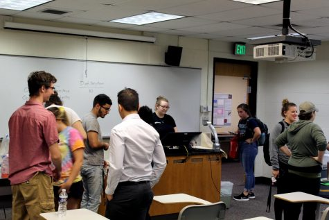Chemistry Club members congregate near the snacks shortly after President Katie McCoy finishes her remarks.