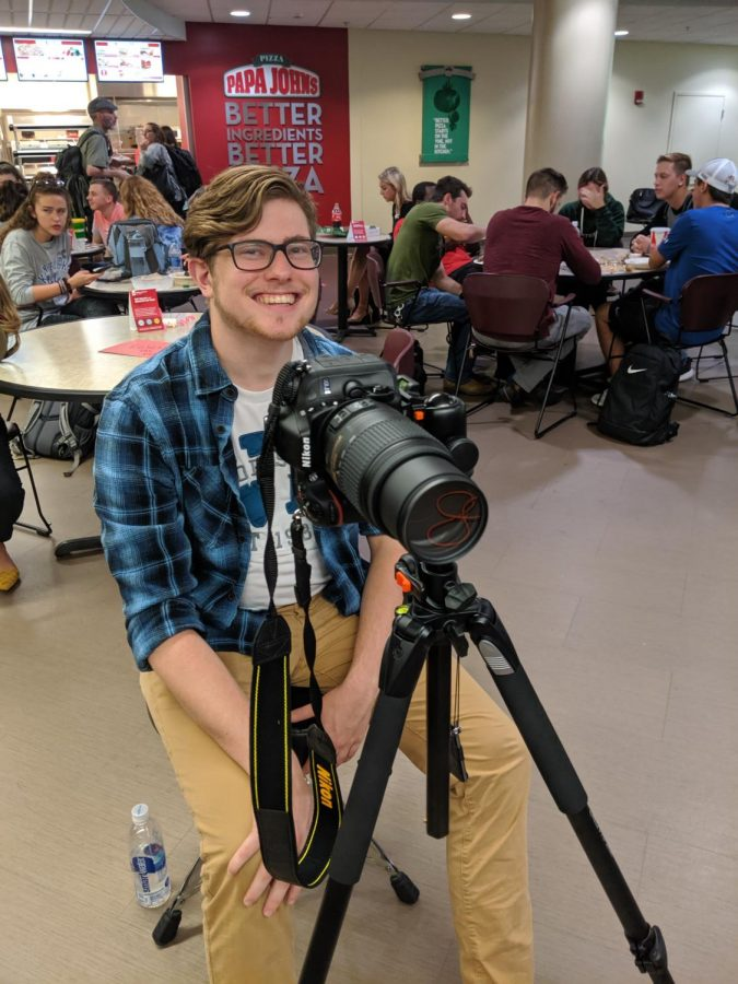 PRSSA Vice President Josh Roy mans the camera at a professional head-shot event the club held this semester.