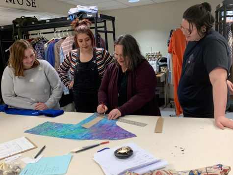 Natalie Bowman gives assistance to her wardrobe crew as they design a new costume. (left to right: Alyssa Fry, Erin Hogle, Natalie Bowman, Alex Conn).