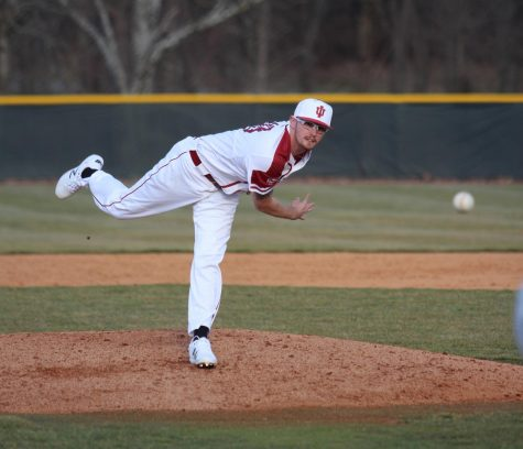 Junior pitcher Cam Harvey throws a pitch during the fourth inning of the Grenadiers' 10-4 victory over Georgetown College.