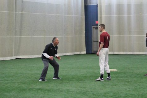 IUS Baseball coach Dave Collins teaches senior Trevor MacDonald baserunning techniques at the end of practice at the Silver Street Indoor Facility in New Albany.