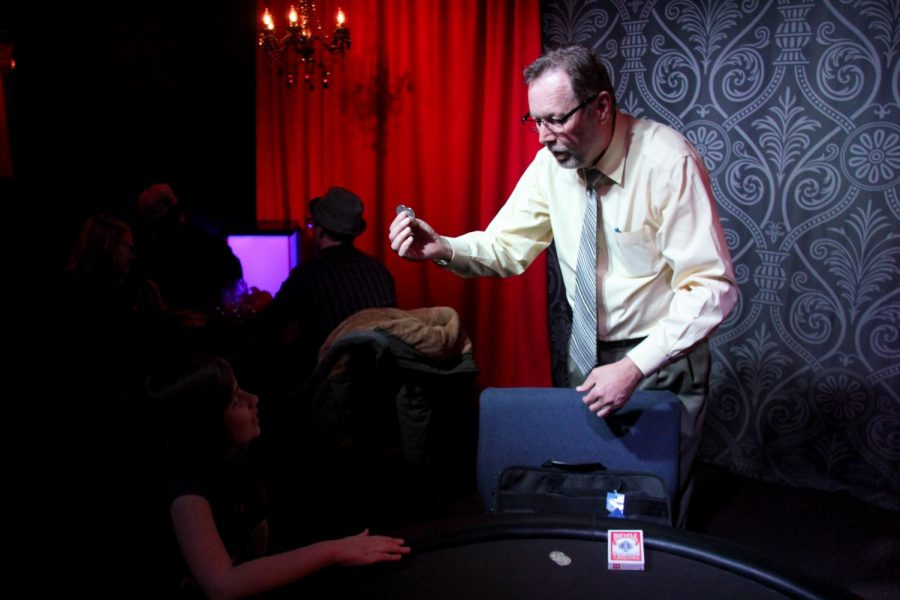 Professional+sleight-of-hand+magician+Ken+Abbot+performs+a+coin+trick+for+a+captivated+audience+member+during+J%26B%E2%80%99s+Thursday+Night+Magic+Hangout.