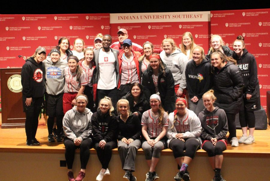 Chris Singleton poses for a picture with the IUS Softball team after the conclusion of the event.