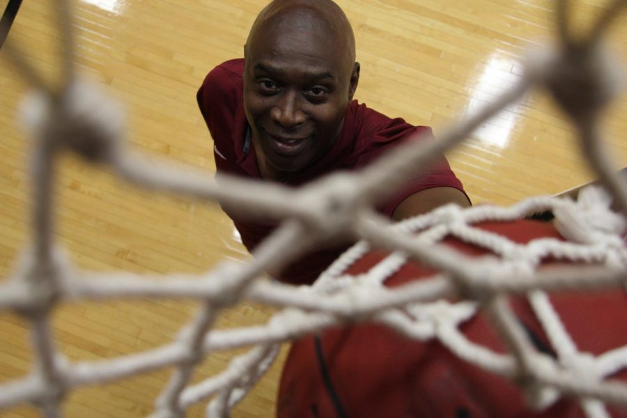 Men's basketball coach Wiley Brown stands under the basket.