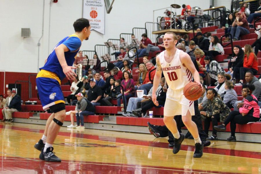 Junior Guard Jared Osborne tries to drive against the Midway defender during the Grenadiers' victory on Saturday, Feb. 15.