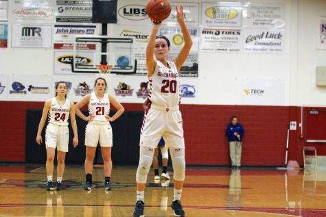 Senior Guard Madi Woods surpasses 1,000 career points with a free throw during the fourth quarter of the Grenadiers' win against Midway.
