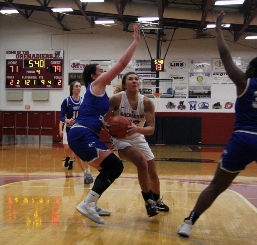 Grenadiers senior forward Hannah Coleman tries to drive through Ohio Christian's defense during the fourth quarter of the RSC Championship.
