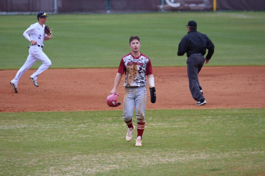 IUS+Baseball+Junior+Clay+Woeste+heads+back+to+the+Grenadier+dugout+after+being+picked+off+to+end+the+fifth+inning+of+game+one+of+a+doubleheader+against+Campbellsville+University+on+March+4.