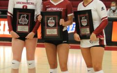 From left to right,IU Southeast Volleyball seniors Alexis Bassett, Kenna Burman, and Hannah Sipe pose with commemorative plaques during senior night festivities prior to the Grenadiers' home match against Asbury University.
