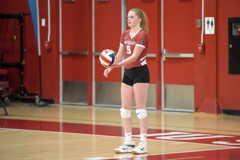 Senior Alexis Bassett prepares to serve during the IUS Volleyball team