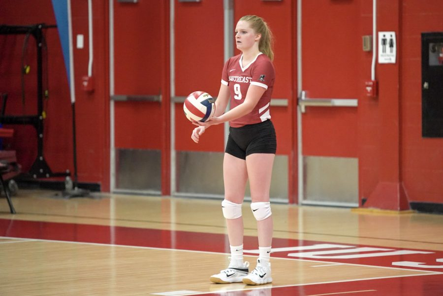 Senior Alexis Bassett prepares to serve during the IUS Volleyball team's season opener against Oakland City University.