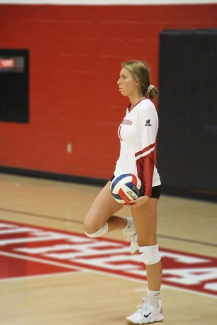 Freshman Brandy Eisenback waits for the signal to serve during the Grenadiers