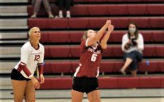 Senior Libero Kenna Burman (Center) sets for Outside Hitter Delaney Nichols during a home match against Asbury on Sept. 25, 2020.