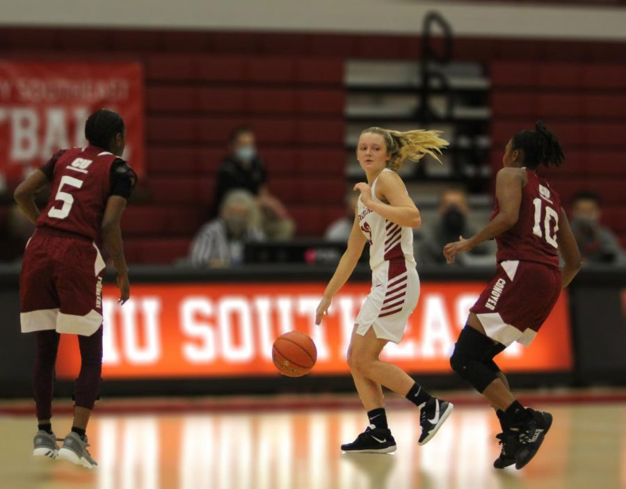 Junior guard Lauren Lambdin draws a double team of Campbellsville - Harrodsburg's Nia Sheckles (5) and E'moni Washington (10) during the second quarter of the Grenadiers' home opener versus the Pioneers.
