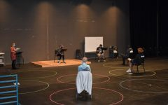 Professor Ashley Wallace teaches her Acting One course in the Robinson Theater, which has been reformatted for COVID-19. Each student has their own six foot circle to move and act in, with the stage allowing for a group of up to twelve students to share the space while still practicing physical distancing. Here the students are performing a cold read of their upcoming final scenes.