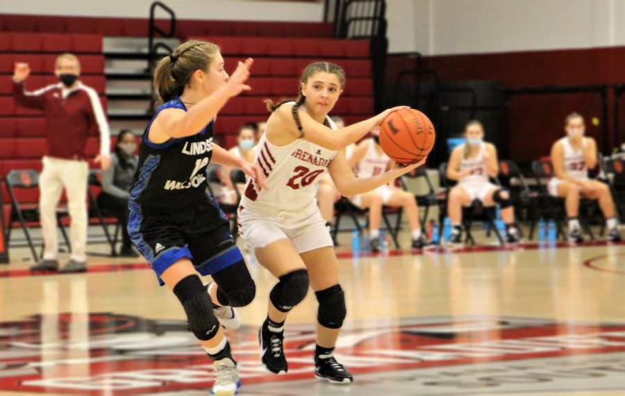 Freshman Guard Isabell Claywell tries to pass the ball around Lindsey Wilson's Reagan Turner in the second quarter of the Grenadiers' home matchup against the Blue Raiders on Nov. 7.
