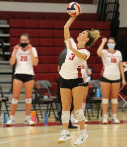 Sophomore Defensive Specialist Santina Schembra prepares to launch the ball midserve during a Grenadier home match against Brescia on Oct. 24, 2020.