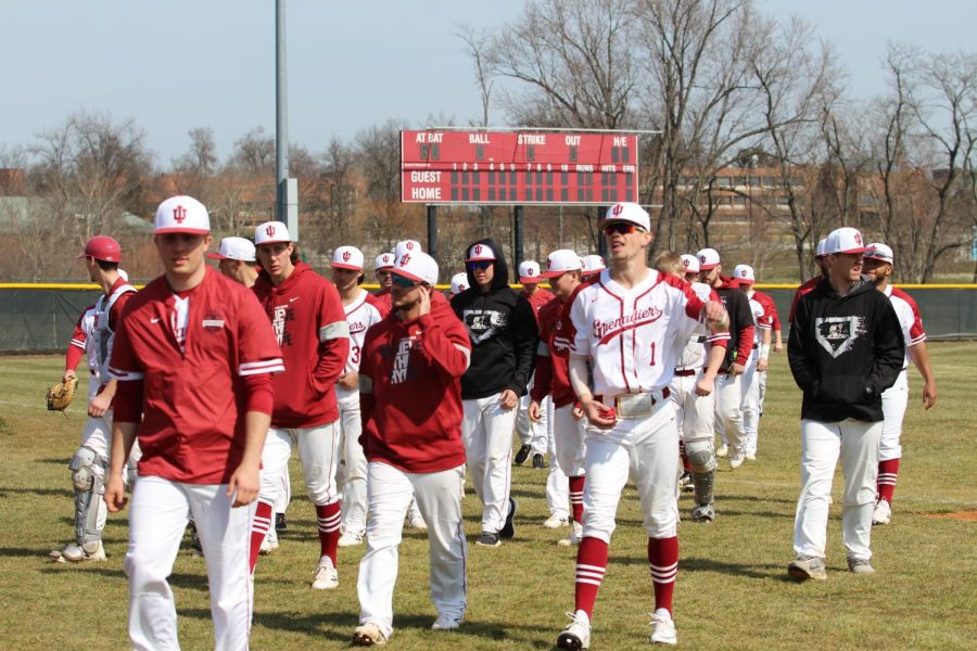 The IUS Baseball team returns to the dugout upon completing throwing practice prior to a contest against West Virginia Tech on March 1, 2020.