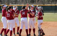 From left to right; Ellie Jackman, Madeline Probus (23), Lindsey Nelson, Brooklyn Gibbs (14), Kelsey Warman, and Reecie Gilliam all share a conversation in the pitcher's circle between innings during a home doubleheader against Saint Mary-of-the-Woods College on March 4, 2020.