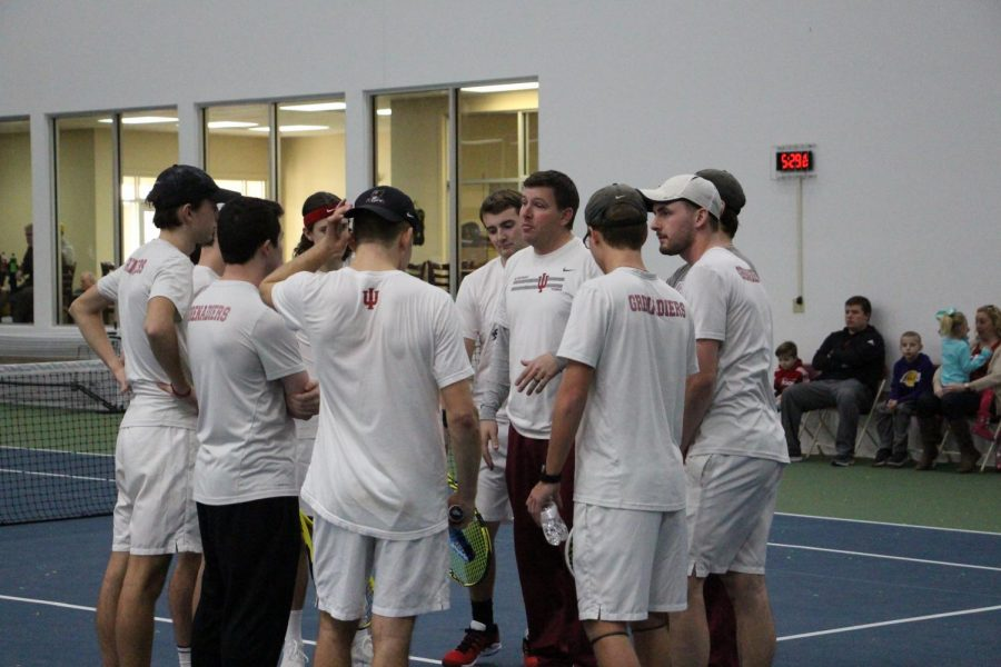 IUS Tennis Coach Joe Epkey gives his Men's Tennis squad a last-minute pep talk prior to their 2020 home opener against #16 Campbellsville.